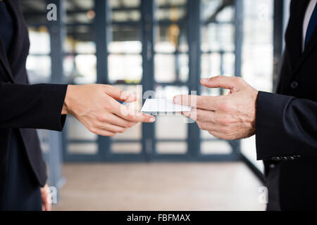Businessman giving his business card - Stock Photo