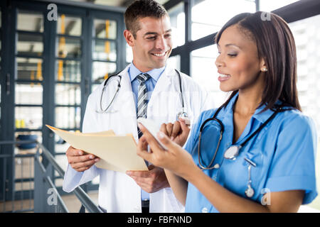 Nurse and doctor looking at a phone - Stock Photo