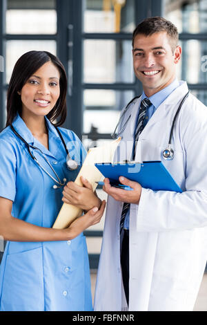 Nurse and doctor holding files - Stock Photo