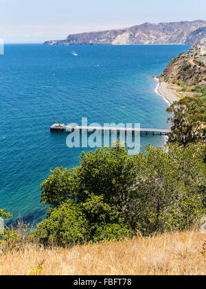 A view from high on a hill above Prisoner's Harbor, Santa Cruz Island, Channel Islands, as a supply boat approaches - Stock Photo