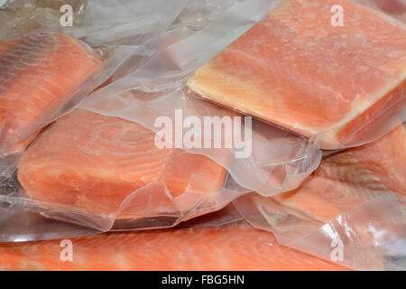 Frozen salmon fillets in vacuum packed plastic packaging - Stock Photo