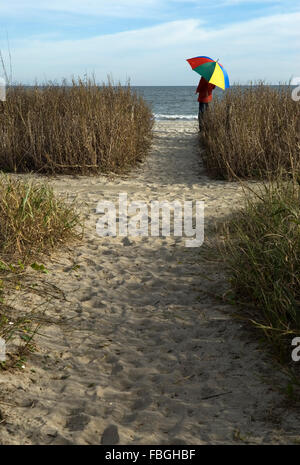Tourist  looking at ocean at Myrtle Beach South Carolina USA - Stock Photo