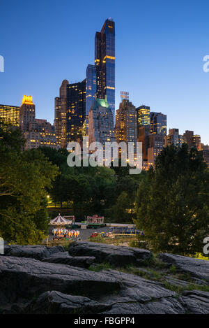 Twilight view of Central Park South skyscrapers including One57, Essex House and the Hampshire House. Manhattan, - Stock Photo