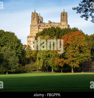 Quiet autumn view of the Beresford Building across Central Park Great Lawn in Upper West Side, Manhattan, New York - Stock Photo