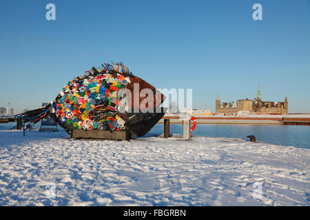 The giant fish, a work of street art made of garbage and old plastic items in snow-covered Elsinore Harbour, the - Stock Photo