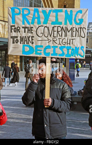 London, UK. 16th January, 2016. An activist outside Kings Cross station taking part in an international day of action - Stock Photo