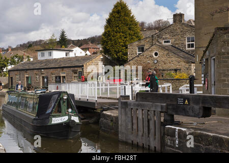 Narrowboat entering & about to pass through, the top lock of The Five Rise Locks  on the Leeds Liverpool Canal, - Stock Photo