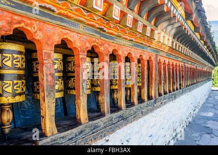 Rotating prayer wheels of Ancient monastery at Thimphu, Bhutan, Chang Gang Kha Lakhang, landmark, woodwork, copy - Stock Photo