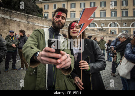 Rome, Italy. 16th Jan, 2016. A David Bowie fans taking photo during tribute to the late music icon in central Rome. - Stock Photo