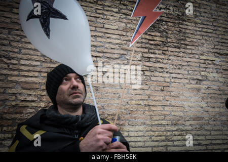 Rome, Italy. 16th Jan, 2016. A David Bowie fan attends a tribute to the late music icon in Central Rome. Legions - Stock Photo