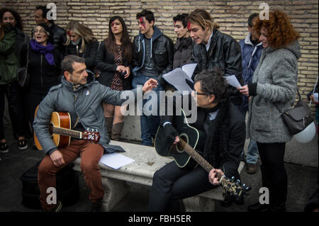 Rome, Italy. 16th Jan, 2016. A David Bowie fans playing guitars during tribute to the late music icon in central - Stock Photo