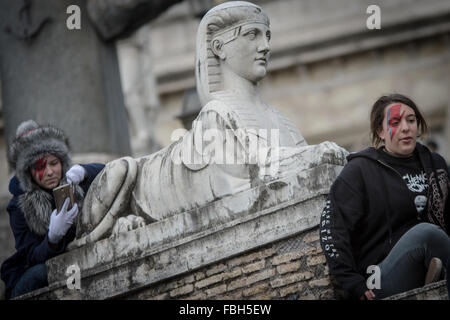 Rome, Italy. 16th Jan, 2016. A David Bowie fan taking photos and sitting during tribute to the late music icon in - Stock Photo