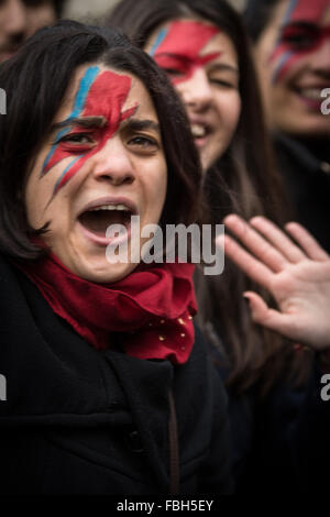 Rome, Italy. 16th Jan, 2016. A David Bowie fans emotional during tribute to the late music icon in central Rome. - Stock Photo