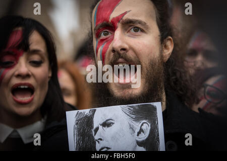 Rome, Italy. 16th Jan, 2016. A David Bowie fans holding his picture during tribute to the late music icon in central - Stock Photo