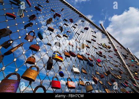 Love locks at the pier of Heiligenhafen, the Baltic Sea - Stock Photo