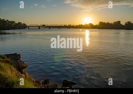 Nowra Bridge stretching over the Shoalhaven River at dawn in New South Wales, Australia. Built in 1881 by specialist - Stock Photo