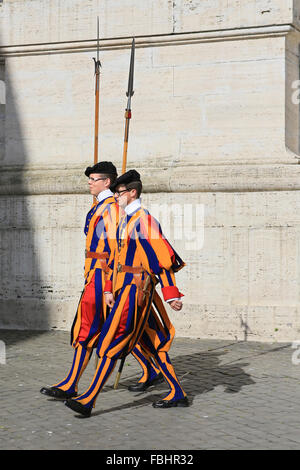 Papal Swiss guards marching outside St Peter's Basilica, Vatican City, Rome, Italy. - Stock Photo