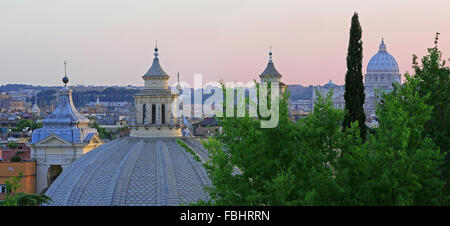 Domes of Santa Maria Churches (and St Peter's Basilica in background) at dusk, Rome, Italy. View from Pinicio Hill - Stock Photo