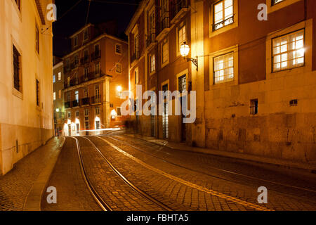 City of Lisbon in Portugal by night, Largo Santa Luzia street with famous tram 28 route - Stock Photo
