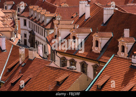 Tourism and sightseeing, view from above over red tile roofs of Prague - Stock Photo
