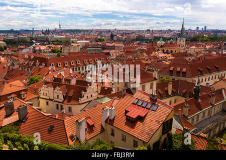 Tourism and sightseeing, view from above over european city Prague red tiled roofs. Good weather, summer day, aerial - Stock Photo