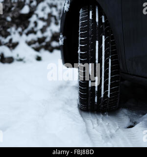 Car tyre in the snow showing tread pattern - Stock Photo