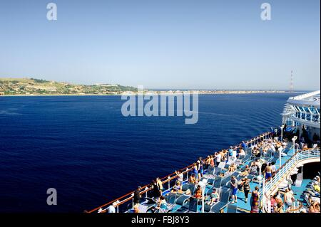 Emerald Princess sailing past Torre Faro, Sicily - Stock Photo