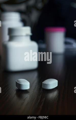 Two pills on the table - Stock Photo