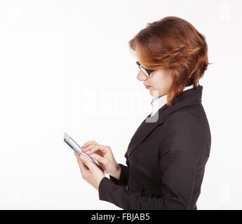 young business woman in black suit and glasses looking at the tablet display - Stock Photo