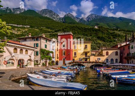 Italy, Veneto, Lake Garda, Cassone di Malcesine, harbour against Monte Baldo - Stock Photo