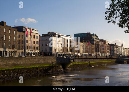 City view of Dublin, capital of Ireland, sunset over the river Liffey - Stock Photo