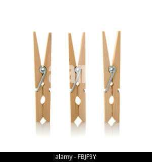 Three wooden cloth pegs on a white background - Stock Photo