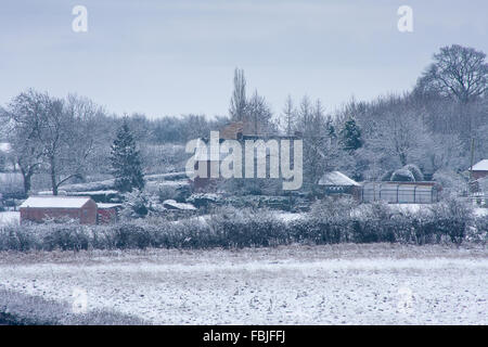 Oakham, Rutland,UK 17th January 2016. Snow covered fields and buildings after the first snow in the Midlands, UK. - Stock Photo