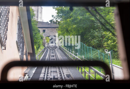 View on cable railroad from cabin of moving up funicular - Stock Photo
