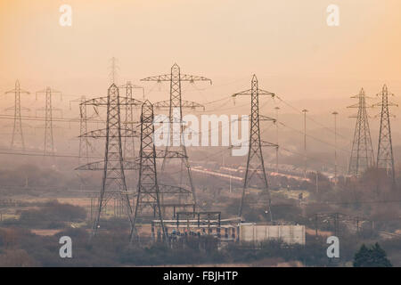 Electricity pylons for the National Grid supplying power to a town in South Wales, UK. - Stock Photo