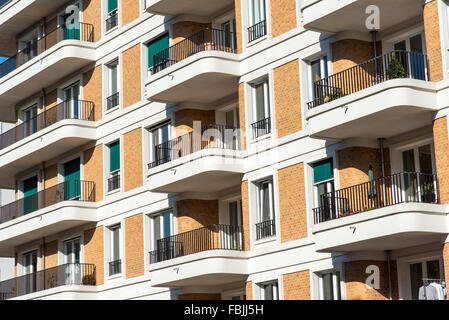 Facade of a modern apartment building in Berlin with many balconies - Stock Photo