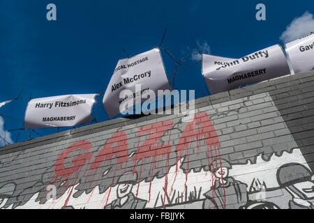 Irish Republican Prisoner names on the international wall located on Belfast's Falls Road above a mural showing - Stock Photo