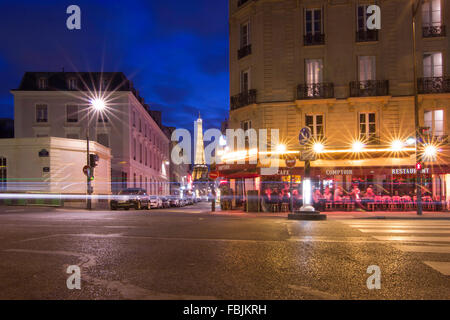 A night street view of Paris, Eiffel tower - Stock Photo