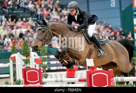 Leipzig, Germany. 17th Jan, 2016. Germany's Niklas Krieg riding Carella jumps over a hurdle in the World Cup show - Stock Photo