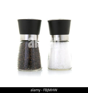 Glass salt and pepper grinders on a white background - Stock Photo