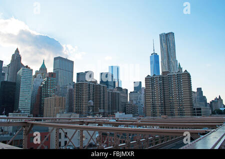 New York, United States of America: Downtown skyline, skyscrapers seen from Brooklyn bridge - Stock Photo