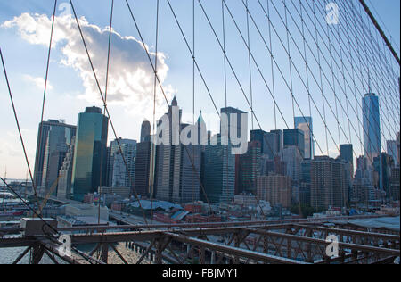 New York, United States of America: Downtown skyline seen from tensioning of Brooklyn bridge - Stock Photo