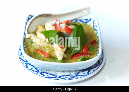 Chicken green curry with vegetables and basil leaves from the Thai menu at the White Horse in Forest Hill, nr Wheatley, - Stock Photo