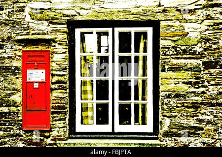 Victorian letter box in a wall at the postoffice of Tintagel, showing the cipher VR for the reign of Queen Victoria; - Stock Photo