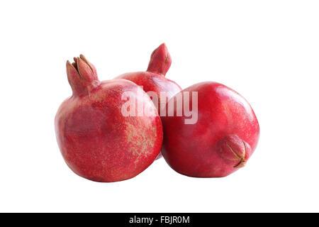 Three big ripe red pomegranates isolated on white background - Stock Photo