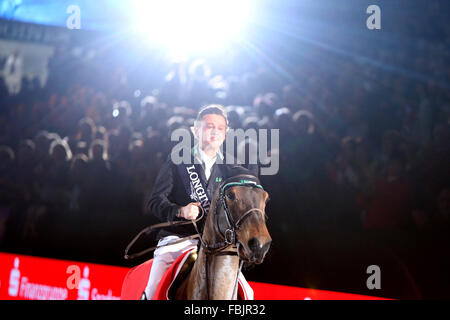 Leipzig, Germany. 17th Jan, 2016. Germany's Niklas Krieg riding Carella celebrates his win in the World Cup show - Stock Photo