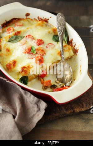 baked cannelloni with cheese, italian food - Stock Photo