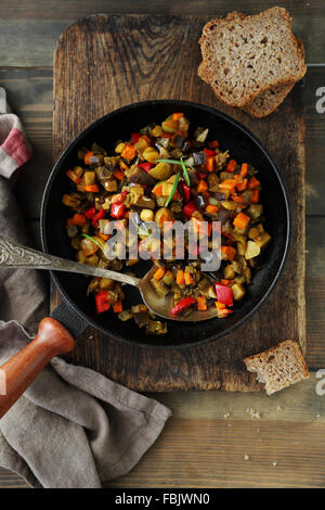 roasted vegetables pieces, ratatouille in pan, food close-up - Stock Photo