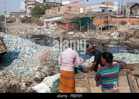 DHAKA, BANGLADESH 11th January 2016: Workers working at a tannery factory in Hazaribagh in Dhaka on January 11, - Stock Photo