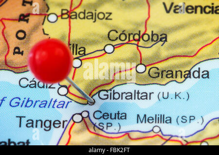 Close-up of a red pushpin in a map of Gibraltar. - Stock Photo